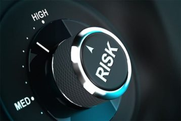 An image featuring a button that says risk and its positioned on high representing security risk