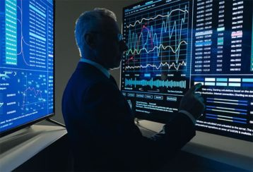 An image featuring a person representing an US agent analyzing some hacking statistics