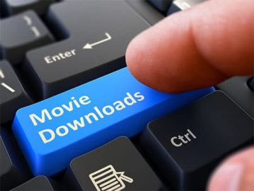 An image featuring a person pressing the shift button that is replaced with the text movie downloads representing downloading movies
