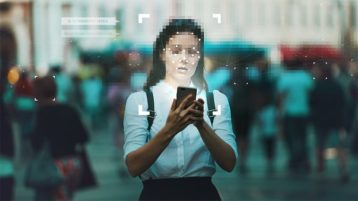 An image featuring a person holding out her phone and her face is blurred representing privacy