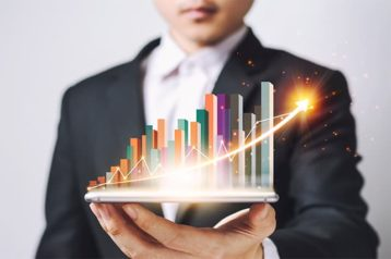 An image featuring a person that is holding statistics in his hand representing performance