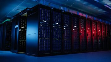 An image featuring multiple servers in a big room with red and blue lightning