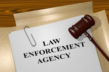 An image featuring files with the law enforcement agency text representing law enforcement agencies