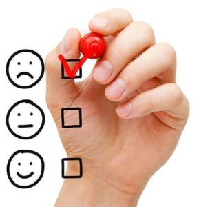 An image featuring a person using his hand with a red pen checking the sad box representing poor service performance