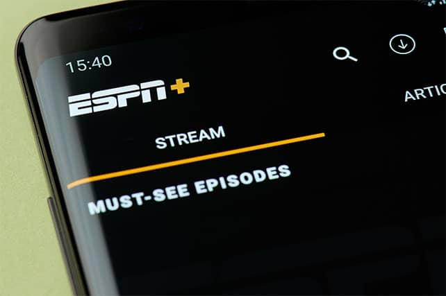 An image featuring a phone with the ESPN+ application opened