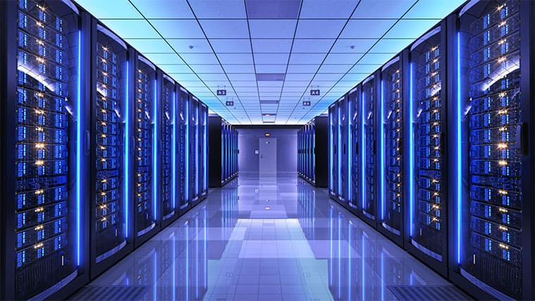 An image featuring a server room with purple lights