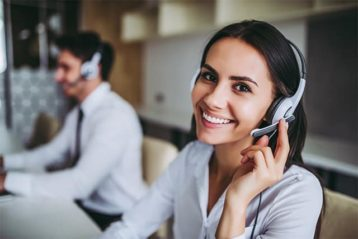 An image featuring two people being happy and doing their customer support job concept