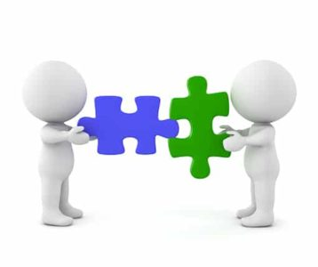 An image featuring two drawn figures holding a compatible puzzle piece in their hands representing compatibility concept
