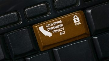 An image featuring a keyboard that has a custom made brown button that has the California consumer privacy act text