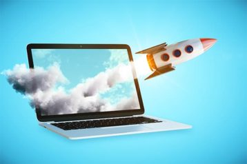 An image featuring a laptop that has a rocket launching from it representing speed up website concept