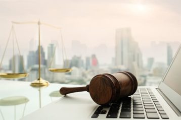 An image featuring a gavel on top of a laptop representing data privacy laws concept