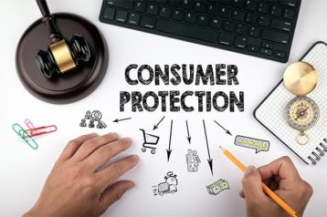 An image featuring consumer protection concept with a gavel next to it and a laptop