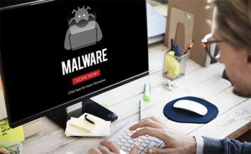 An image featuring a person using his MacBook with text that says malware and has a malware logo on it representing computer virus malware infection