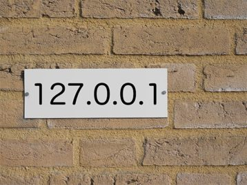 An image featuring a wall with the numbers of localhost in front of it representing localhost concept