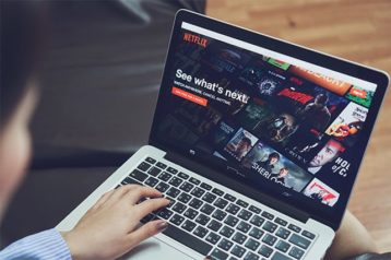 An image featuring a person watching Netflix concept