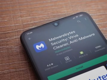 An image featuring a phone that has opened malwarebytes on the playstore concept