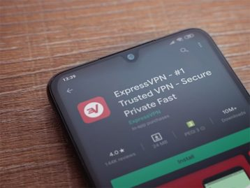 An image featuring a phone that has ExpressVPN app searched concept