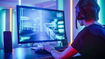 An image featuring a person playing a online video game representing online gaming concept